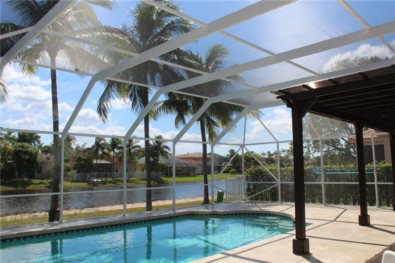 Photo pool enclosure and patio by Florida Screen Repair